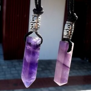 Polished Clear, Rose and Amethyst quartz drilled pendants.