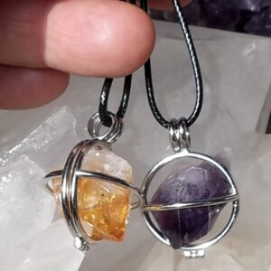 Raw crystals in hinged cage pendants